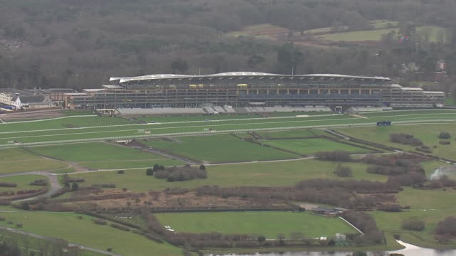 shows aerial shots ascot racecourse and stands on a grey miserable winter's day, on 18th december, 2019 in england, united kingdom - イギリス アスコット競馬場点の映像素材/bロール