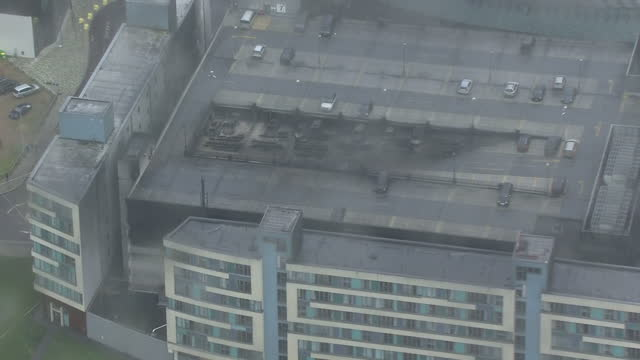 Shows aerial shots blackened walls caused by smoke from fire on outside of multistorey car parkMore than a thousand cars have been destroyed in a...