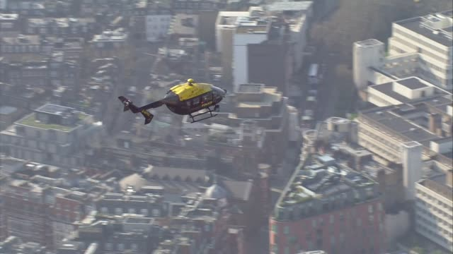 Shows aerial shots Brexit Leave supporters gathered outside the Houses of Parliament to protest Brexit delay as police helicopter circles above them...