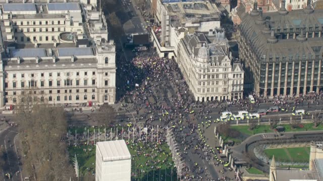 Shows aerial shots Brexit Leave supporters gthered near stage outside the Houses of Parliament to protest Brexit delay While MPs were debating the...