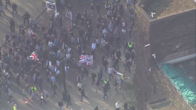 Shows aerial shots Brexit Leave supporters marching past Horseguards Parade heading towards Parliament to protest Brexit delay While MPs were...