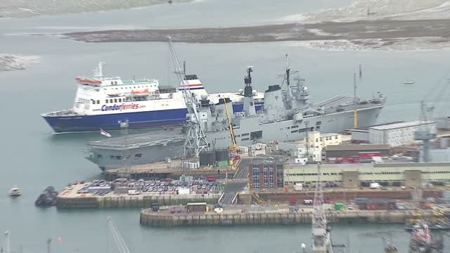 shows aerial shots british navy aircraft carrier hms illustrious docked in portsmouth in 2013 with pan out across the historic dockyards and... - hms illustrious r06 stock videos and b-roll footage