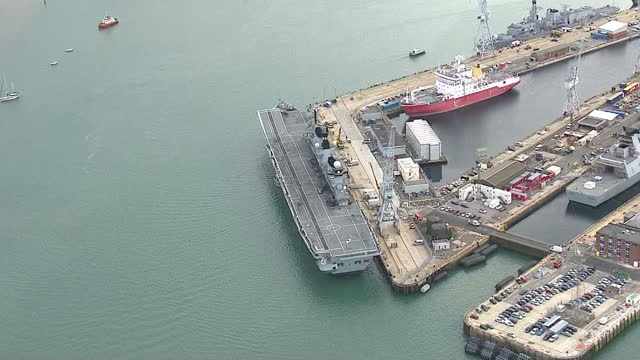 shows aerial shots british navy aircraft carrier hms illustrious docked in portsmouth in 2013 plans to save the last working aircraft carrier in the... - hms illustrious r06 stock videos and b-roll footage