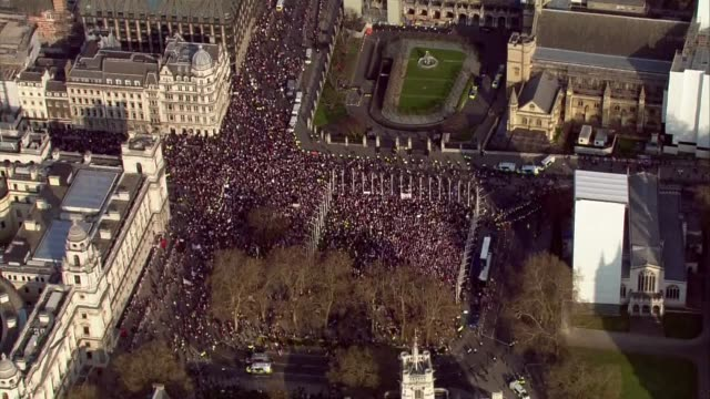 Shows aerial shots circling around Brexit Leave supporters gathering outside the Houses of Parliament to protest Brexit delay While MPs were debating...