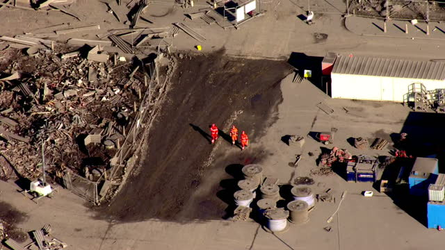 shows aerial shots construction vehicles and heavy lifting equipment near collapsed building with fire and rescue personnel walking nearby rescuers... - didcot stock videos and b-roll footage