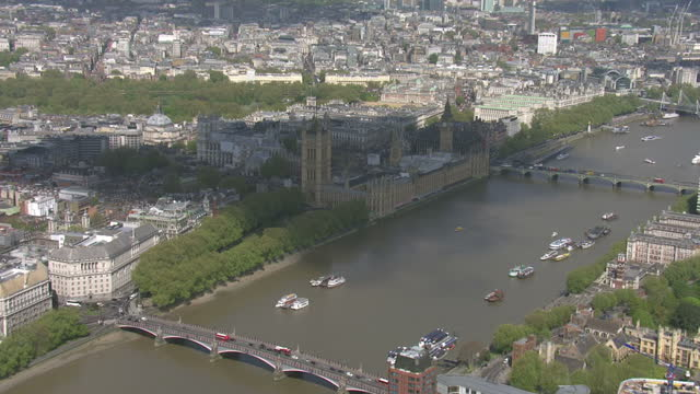 shows aerial shots dark cloud shadow moving away from covering houses of parliament in london on a sunny day. uk prime minister theresa may has... - sunny video stock e b–roll