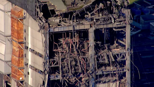 shows aerial shots didcot power station with zoom in to debris and wreckage of collapsed building fire crews have said they have found no signs of... - didcot stock videos and b-roll footage