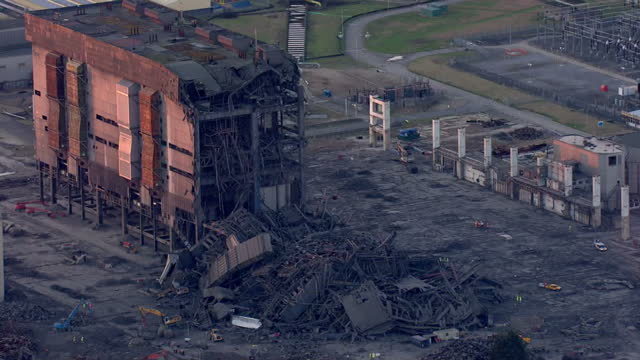 shows aerial shots didcot power station with zoom in to part collapsed building in disused part of power station with emergency services nearby one... - didcot stock videos and b-roll footage