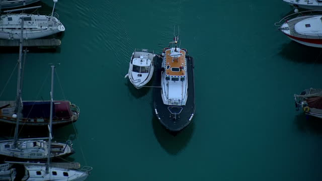 Shows aerial shots Dover Harbour Pilot's boat taking small boat in which migrants tried to cross the English Channelthrough Dover Harbour and into...