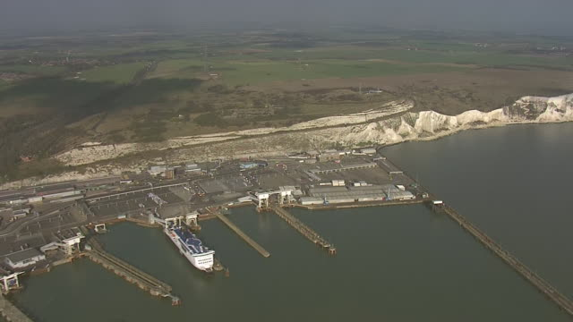 shows aerial shots dover harbour, sea front, port and ferries and white cliffs heading east and south foreland lighthouse. a dinghy containing... - sea channel stock videos & royalty-free footage