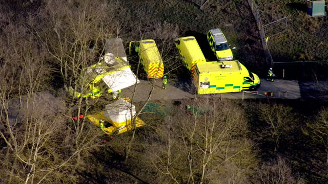 shows aerial shots emergency services including fire service fire engines ambualnce and police vehicles parked near to the scene of didcot collapsed... - didcot stock videos and b-roll footage