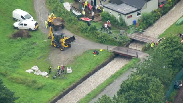 shows aerial shots emergency work being carried out to prevent collapse of damaged dam at toddbrook reservoir. it's survived for two centuries but... - damaged stock videos & royalty-free footage