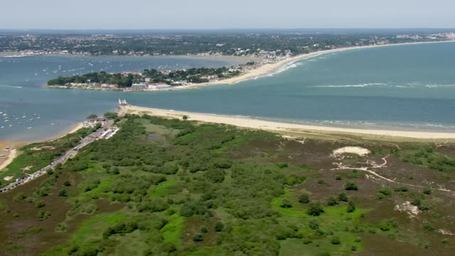 shows aerial shots entrance to poole harbour with sandbanks in the background on a sunny summer's day on 28th june 2019 in dorset england united... - english channel stock videos & royalty-free footage