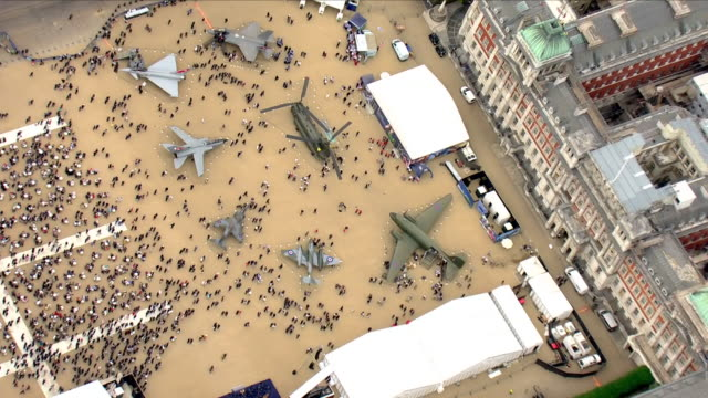 vídeos de stock e filmes b-roll de shows aerial shots examples of various aircraft from the raf's history installed on horse guards parade in london for the raf's centenary... - centenário