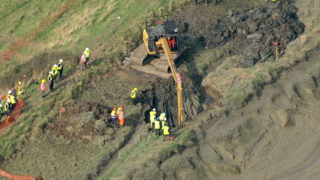 shows aerial shots excavation of world war ii hurricane plane including digger and members of the team watching progress near the thames estuary now... - baufahrzeug stock-videos und b-roll-filmmaterial