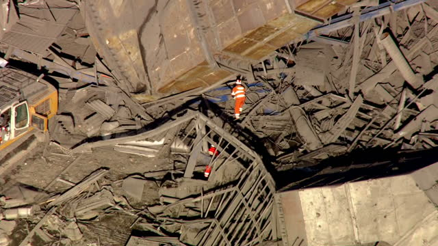 shows aerial shots fire and rescue workers working amongst the twisted metal debris of the collapsed building rescuers say they believe that three... - didcot stock videos and b-roll footage