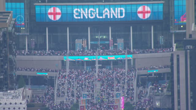 shows aerial shots football fans leaving wembley stadium following the england v germany euros 2020 match. england are preparing to face germany for... - fan enthusiast stock videos & royalty-free footage