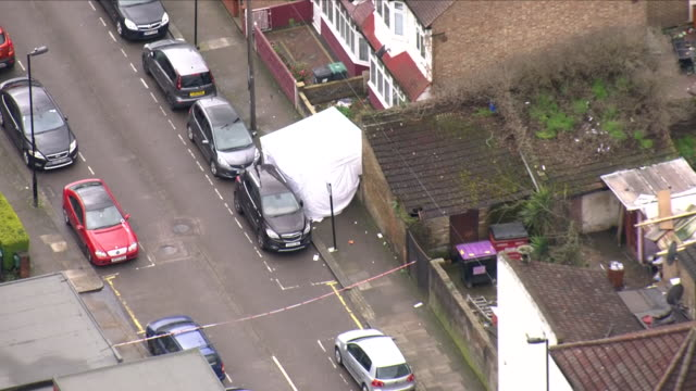 shows aerial shots forensics tent covering crime scene in tottenham where tanesha melbourne was shot and killed there are concerns tonight about the... - criminal investigation stock videos & royalty-free footage