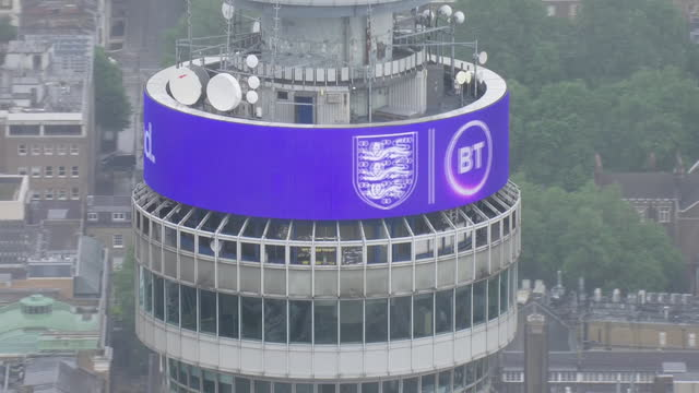 shows aerial shots good luck message to england football team on top of bt tower in central london before the england v germany euros 2020 match.... - digital display stock videos & royalty-free footage