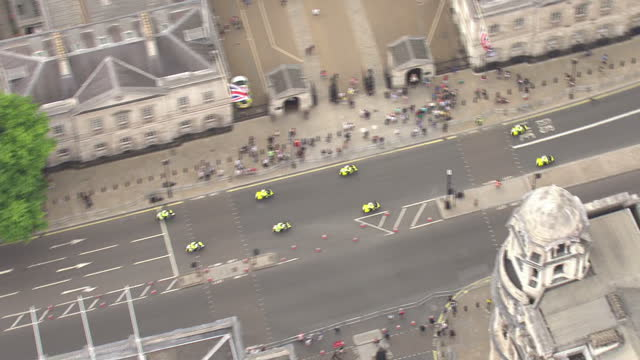 Shows aerial shots groupfo f eight motorcyclists driving in formation along Whitehall towards Trafalgar Square on 11th June 2107 in London England