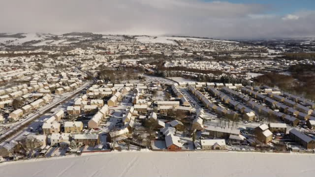 shows aerial shots houses and landscape covered in snow on outskirts of edinburgh, scotland. the lowest uk temperature for more than a decade was... - winter stock videos & royalty-free footage