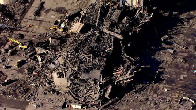 shows aerial shots huge pile of debris and wreckage from collapsed building and pan across remaining standing structure at didcot power station... - didcot stock videos and b-roll footage
