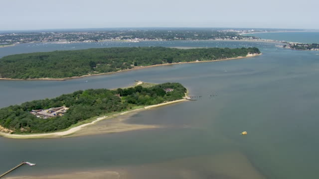 Shows aerial shots islands including Brownsea Island in Poole Harbour with Sandbanks in the background on a sunny summer's day on 28th June 2019 in...