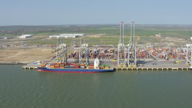 Shows aerial shots London Gateway Port including container ship alongside dock unloading containers on 1st April 2019 in London England United Kingdom