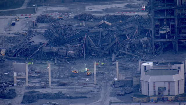 shows aerial shots massive pile of rubbles from collapsed building at didcot power station with emergency services personnel on site and zoom out to... - didcot stock videos and b-roll footage