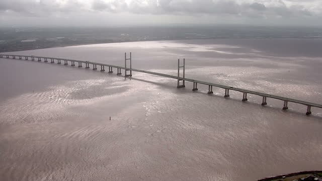 shows aerial shots of the severn bridge crossing between aust south gloucestershire and chepstow monmouthshire south wales on august 29 2014 in wales - gloucestershire stock videos and b-roll footage