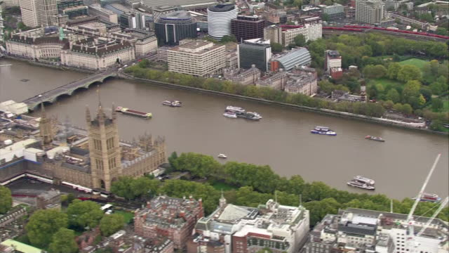shows aerial shots pan across st james park and westminster to south side of thames, showing government offices and houses of parliament on grey... - city of westminster london stock videos & royalty-free footage