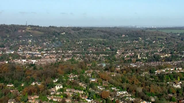 shows aerial shots pan from skyscrapers in central london to housing in suburban london surrounded by fields and trees on november 28 2016 in london... - surrounding stock videos and b-roll footage