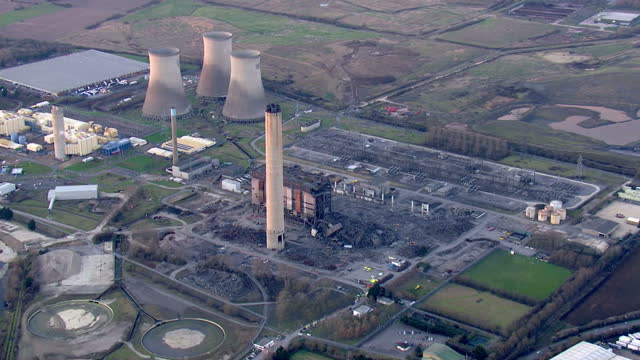 shows aerial shots panning round collapsed building at didcot power station with large pile of rubble and emergency services personnel on site one... - didcot stock videos and b-roll footage