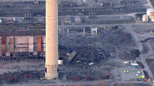 shows aerial shots part of building collapse at disused didcot power station with emergency services vehicles nearby one person has been killed and... - didcot stock videos and b-roll footage