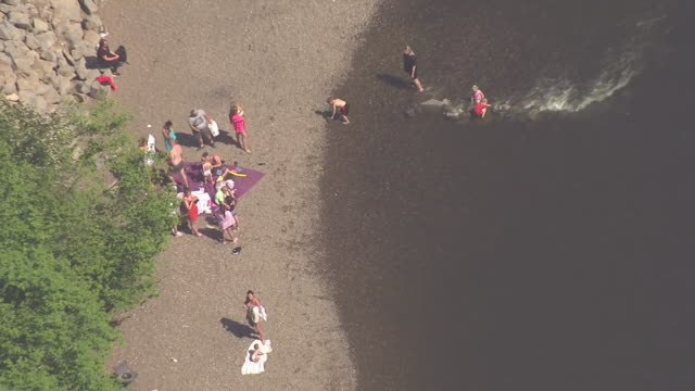 shows aerial shots people sunbathing and playing in water along river servern near bewdley in worcestershire, with rocks showing through showing low... - spring flowing water stock videos & royalty-free footage