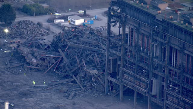 shows aerial shots pile of rubble from collapsed building at didcot power station with zoom out to show entire site including cooling towers one... - didcot stock videos and b-roll footage