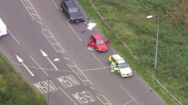 shows aerial shots police and emergency services vehicles near red vehicle whose driver was fatally shot a man has died following an incident... - emergency services vehicle stock videos and b-roll footage