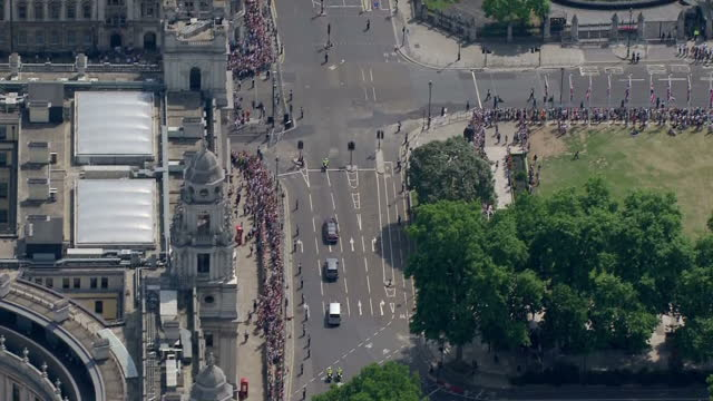 shows aerial shots queen's motorcade arriving at houses of parliament for the state opening of parliament the queen's speech was dominated by... - the queen's speech state opening of uk parliament stock videos & royalty-free footage