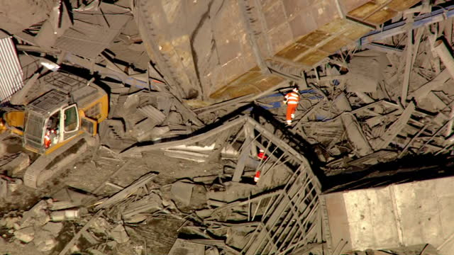 shows aerial shots rescue workers searching through the collapsed building at didcot power station fire crews have said they have found no signs of... - didcot stock videos and b-roll footage