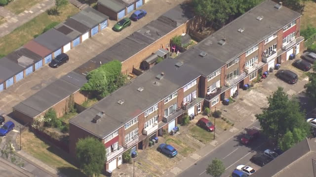 shows aerial shots residential area in west london showing houses and small blacks of apartments. a report into covid-19 among black, asian and... - flat stock videos & royalty-free footage