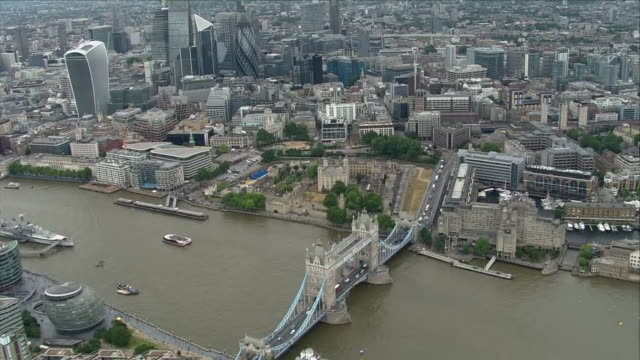 Shows aerial shots River Thames Tower Bridge and the Tower of London under overcast skies on 10th July 2018 in London England United Kingdom