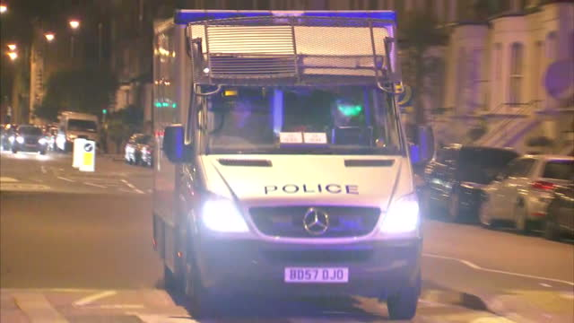 Shows aerial shots scene of terror attack on Finsbury Park mosque in London including van used in attack forensics tents over crime scene and police...