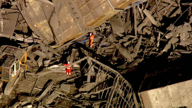 shows aerial shots search and rescue workers amongst rubble of collapsed power station exterior shots emergency workers on site exterior shots... - didcot stock videos and b-roll footage