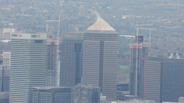 shows aerial shots skyscrapers at canary wharf and the station on 2nd april 2019 in london england united kingdom - skyline stock videos & royalty-free footage