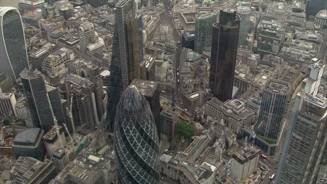 shows aerial shots skyscrapers in the city of london england exterior shots the gherkin building in london interview with shadow chancellor and... - cable box stock videos and b-roll footage