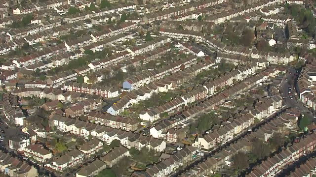 Shows aerial shots streets of lowrise housing in suburbia on November 28 2016 in London England
