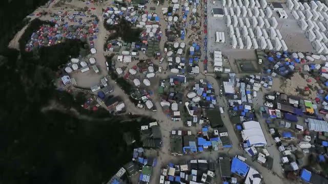shows aerial shots taken by a drone over top of the jungle migrant camp hauliers have attacked plans for the uk to build a twomillion pouinds wall in... - calais stock videos & royalty-free footage