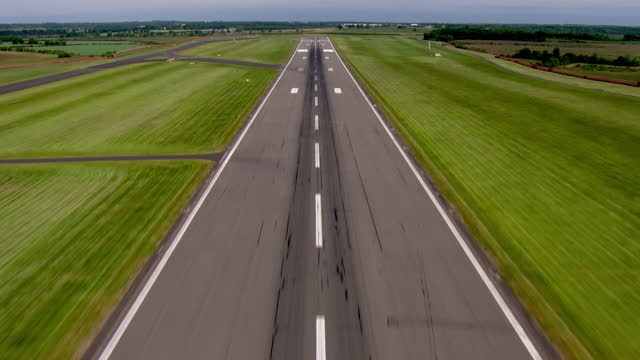 shows aerial shots taking off from runway of newcastle international airport, on 1st july, 2021 in sunderland, england, united kingdom - dividing line stock videos & royalty-free footage