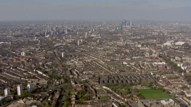 shows aerial shots travelling over south london to central london and across river to north bank on 11th april 2019 in london england united kingdom - skyline stock videos & royalty-free footage