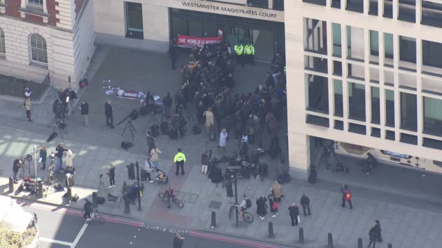 shows aerial shots westminster magistrates court police officers protesters media personnel gathered around kristinn hrafnsson giving press... - courthouse stock videos & royalty-free footage